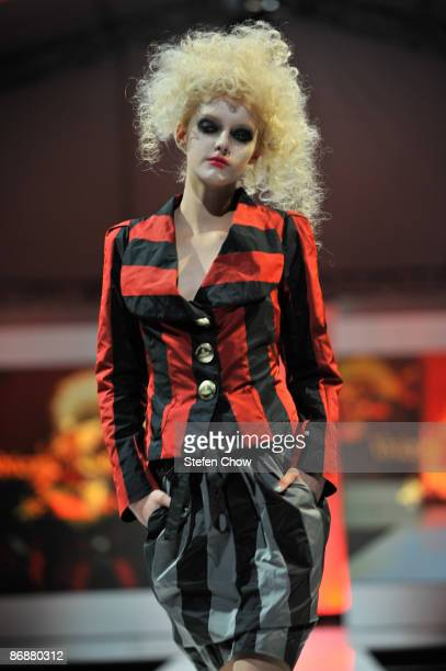 Model showcases designs by Vivienne Westwood for her Autumn/Winter 2009 collection on the catwalk at the Ngee Ann City Civic Plaza on Day 5 and last...