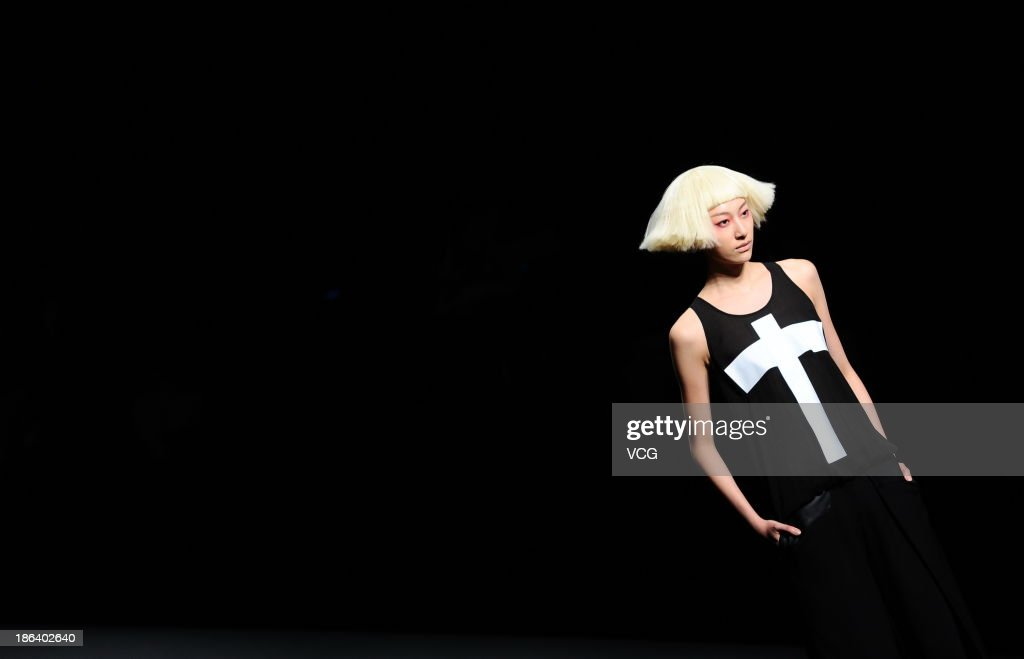A model showcases designs by Wang Tao on the runway at the BROADCAST Wang Tao Collection show during Mercedes-Benz China Fashion Week Spring/Summer 2014 at Beijing Hotel on October 30, 2013 in Beijing, China.