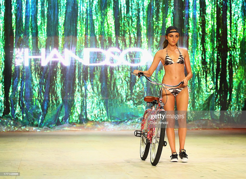 A model showcases designs by We Are Handsome on the runway at the MBFWA Trends show during Mercedes-Benz Fashion Festival Sydney 2013 at Sydney Town Hall on August 21, 2013 in Sydney, Australia.