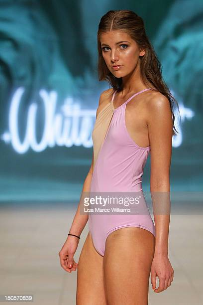 A model showcases designs by White Sands during the Miami Swim show as part of the MercedesBenz Fashion Festival Sydney 2012 at Sydney Town Hall on...