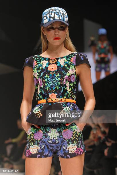 A model showcases designs by White Suede on the catwalk on day 5 of Melbourne Spring Fashion Week 2012 at Melbourne Town Hall on September 7 2012 in...