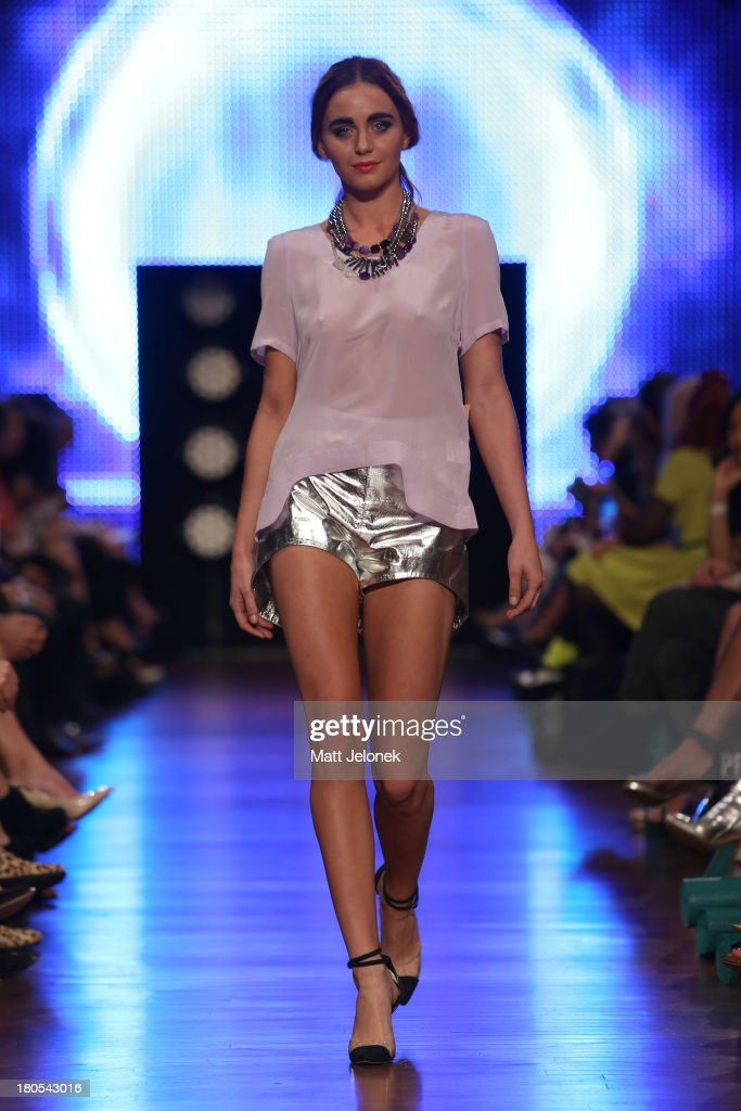A model showcases designs by Wild Horses on the runway during Perth Fashion Festival at The Western Australian Museum on September 14, 2013 in Perth, Australia.