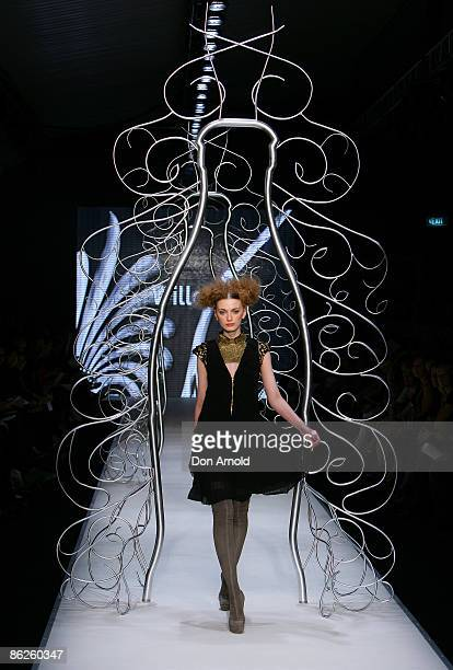 Model showcases designs by Willow during the Little Black Dress show on the catwalk at the Overseas Passenger Terminal, Circular Quay on day two of...