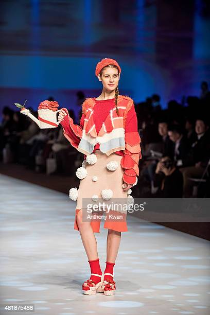 A model showcases designs by Wing Lam on the runway during the Knitwear Symphony 2015 on day 3 of Hong Kong Fashion Week Fall/Winter 2015 at the Hong...