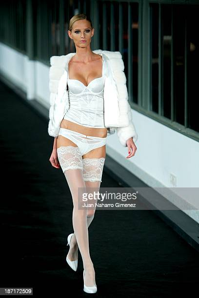 A model showcases designs by Women'secret on the runway during Women'secret New Collection presentation 20th anniversary at Botanic Garden on...