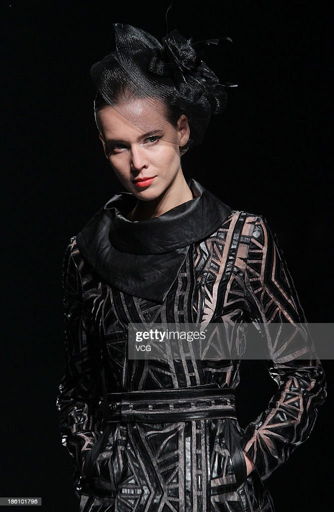 A model showcases designs by Xie Jiaqi on the runway at the K.G. S Xie Jiaqi Collection show during Mercedes-Benz China Fashion Week Spring/Summer 2014 at Beijing Hotel on October 28, 2013 in Beijing, China.