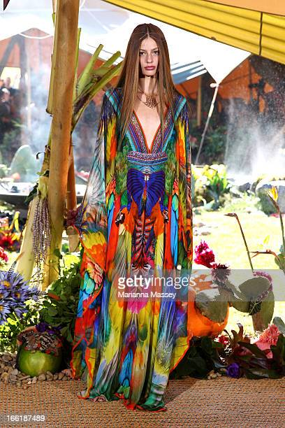 A model showcases designs by XXX on the runway at the Camilla show during MercedesBenz Fashion Week Australia Spring/Summer 2013/14 at Centennial...
