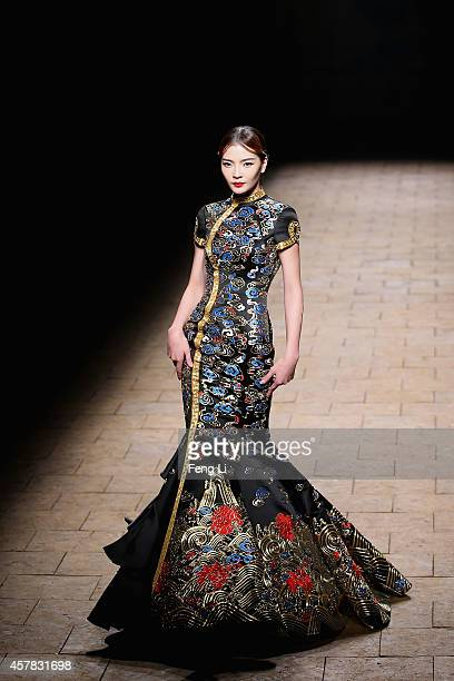 A model showcases designs by Zhang Zhifeng on the runway at 2015 NETIGER Haute Couture Collection show during MercedesBenz China Fashion Week...