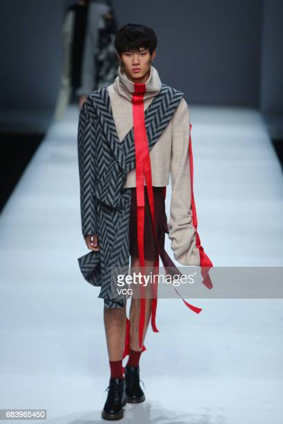 Model showcases designs designed by graduates of College of Textile and Clothing of Jiangnan University on the runway during day one of China...