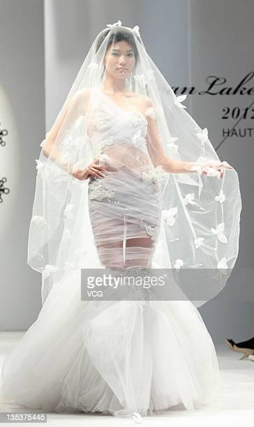 Model showcases designs during 2012 LAN YU Wedding Dress Show on December 8, 2011 in Beijing, China.