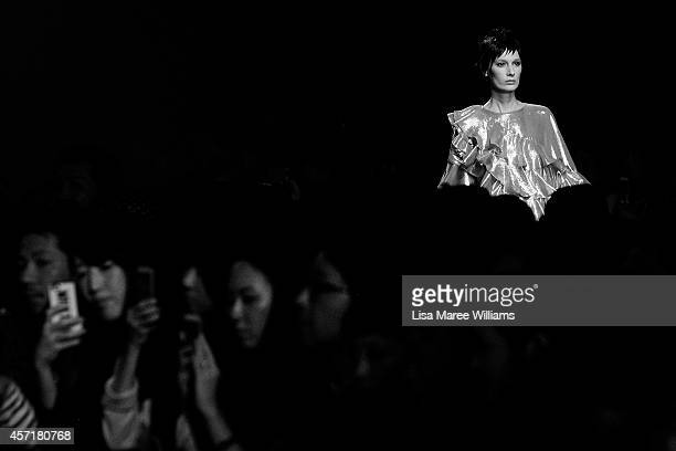 A model showcases designs during the DRESSCAMP show as part of Mercedes Benz Fashion Week TOKYO 2015 S/S at Shibuya Hikarie on October 13 2014 in...