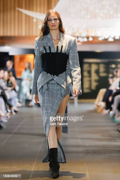 Model showcases designs during the Gala Runway at Melbourne Fashion Festival at National Gallery of Victoria on March 11, 2021 in Melbourne,...