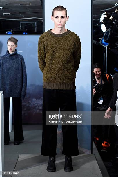 Model showcases designs during the John Smedley presentation during London Fashion Week Men's January 2017 collections at BFC Presentation Space on...