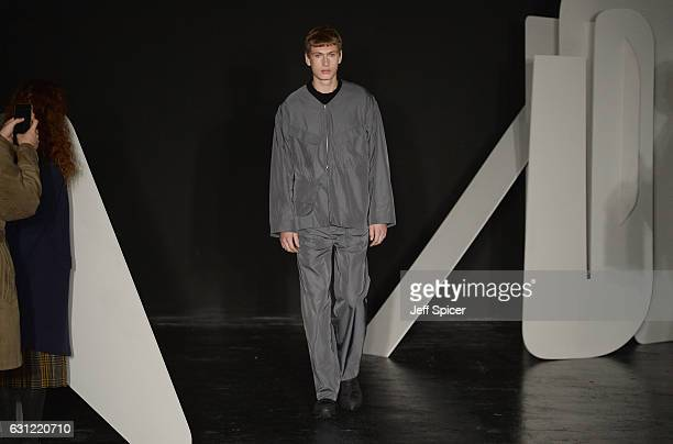 A model showcases designs during the Kiko Kostadinov presentation during London Fashion Week Men's January 2017 collections at BFC Presentation Space...
