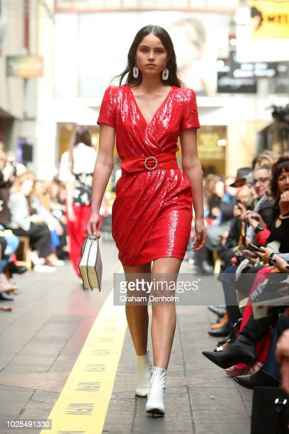 A model showcases designs during the MFW Union Lane runway during Vogue American Express Fashion's Night Out on August 31 2018 in Melbourne Australia