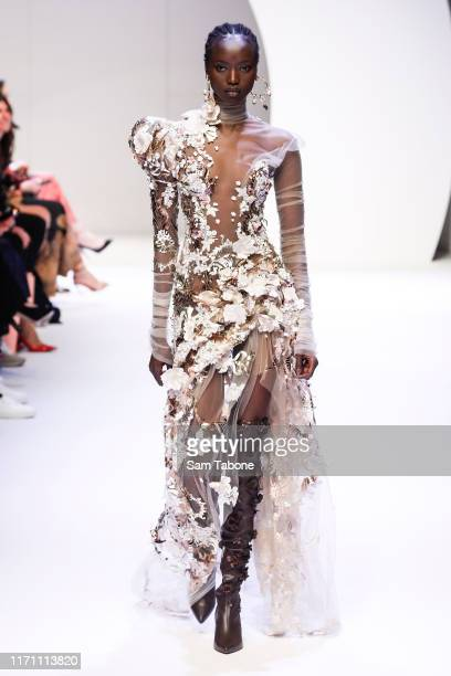 A model showcases designs during the Opening Town Hall Runway at Melbourne Fashion Week at Melbourne Town Hall on August 30 2019 in Melbourne...