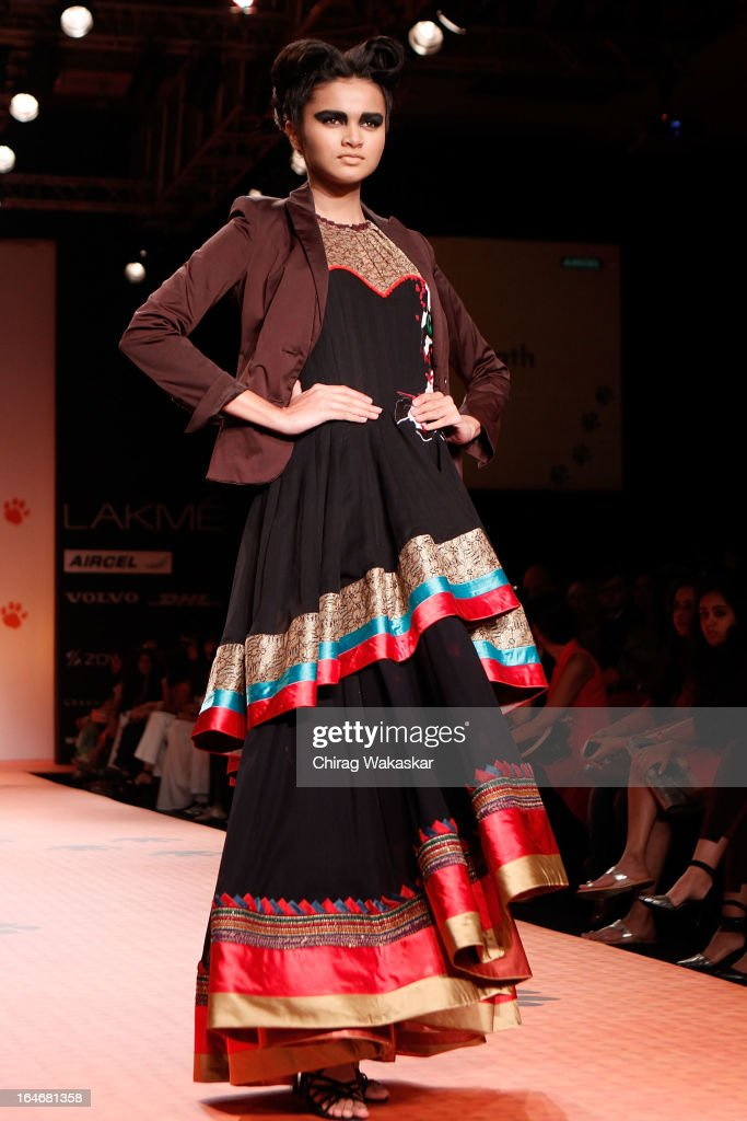 A model showcases designs during the Save our Tigers show on the runway during day five of Lakme Fashion Week Summer/Resort 2013 on March 26, 2013 at Grand Hyatt in Mumbai, India.