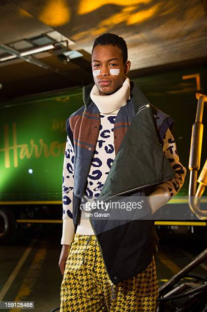 Model showcases designs during the Vivienne Westwood Man presentation at the London Collections: MEN AW13 at Harrods on January 8, 2013 in London,...