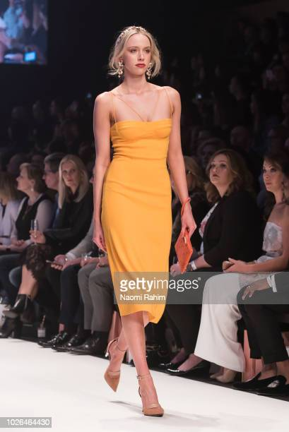 A model showcases designs during Townhall Runway Three show at Melbourne Fashion Week on September 3 2018 in Melbourne Australia