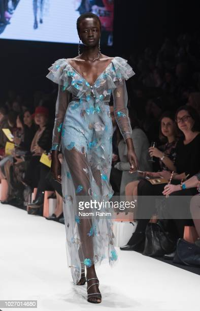 A model showcases designs during Townhall Runway Three show at Melbourne Fashion Week on September 4 2018 in Melbourne Australia