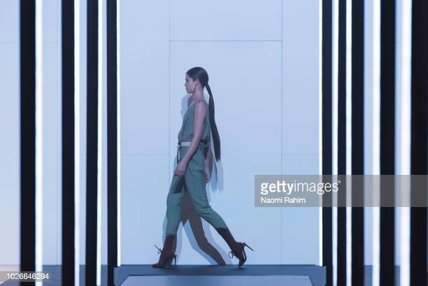 A model showcases designs during Townhall Runway Two show at Melbourne Fashion Week on September 4 2018 in Melbourne Australia