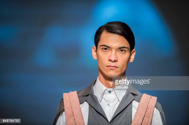 Model showcases designs Extrication by Tommy Chong during the Visceral Instinct show by Raffles Hong Kong as part of the Fashion Week for Spring /...