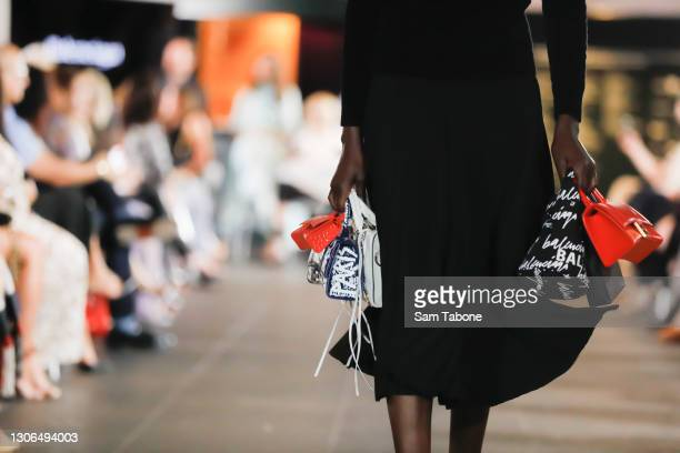 Model showcases designs from Balenciaga during the Gala Runway at Melbourne Fashion Festival at National Gallery of Victoria on March 11, 2021 in...