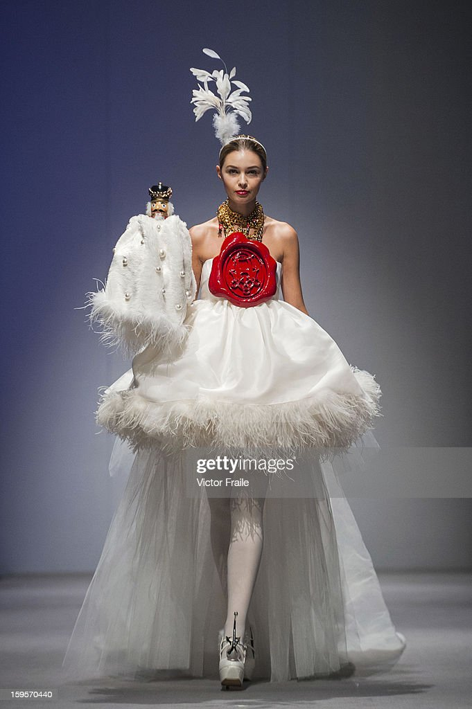 A model showcases designs of Andy Ho on the runway during the Designer's Collection Show on day 3 of Hong Kong Fashion Week Autumn/Winter 2013 at the Convention and Exhibition Centre on January 16, 2013 in Hong Kong, China.