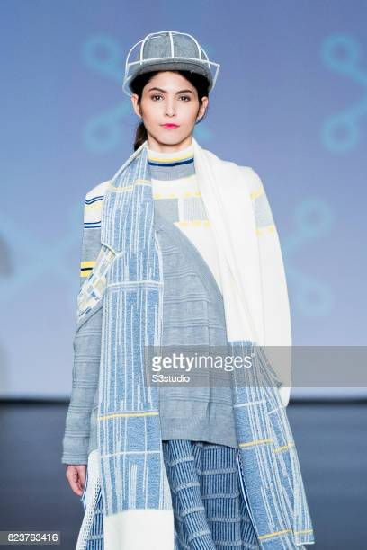 A model showcases designs of Cayley Wong on the runway during the Knitwear Symphony 2016 The 6th Hong Kong Young Knitwear Designers' Contest on the...