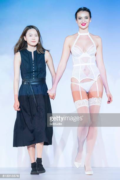 Model showcases designs of CC Chan Sze Sze and Hannah Cheung Yuen Ling on the runway during the PolyU Intimate Fashion Show 2017 on the Day 3 of the...