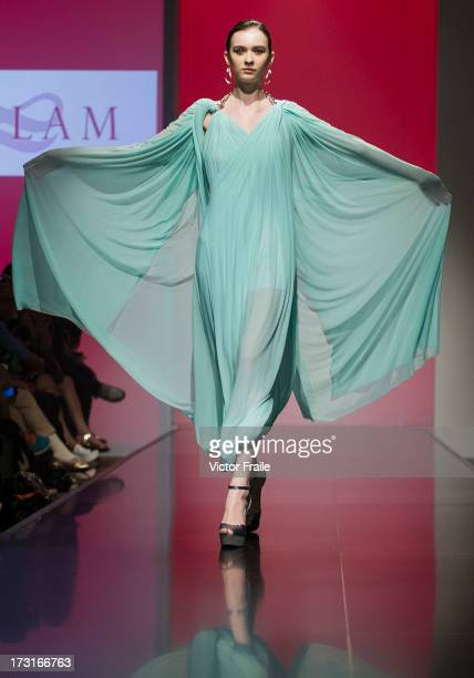 A model showcases designs of Christine Lam on the runway during the Designer Collection Show on day 2 of Hong Kong Fashion Week Spring/Summer 2013 at...