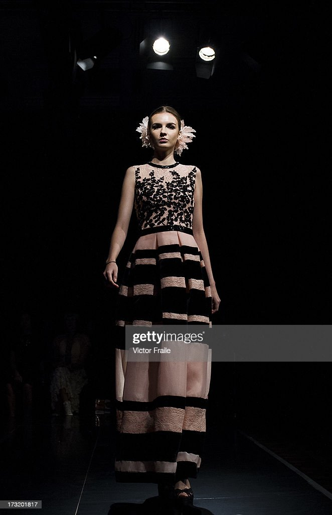 A model showcases designs of Gregorious Vici on the runway during the Brand Collection show on day 3 of Hong Kong Fashion Week Spring/Summer 2013 at the Hong Kong Convention and Exhibition Centre on July 10, 2013 in Hong Kong, China.