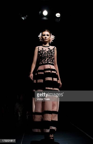 A model showcases designs of Gregorious Vici on the runway during the Brand Collection show on day 3 of Hong Kong Fashion Week Spring/Summer 2013 at...
