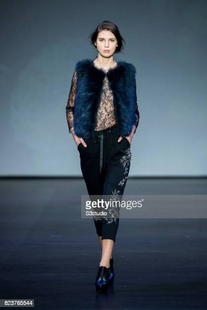 A model showcases designs of Hidy Ng on the runway during the Hidy Ng SS2017 ReadytoWear Collection show on the Day 3 of the CentreStage Hong Kong...