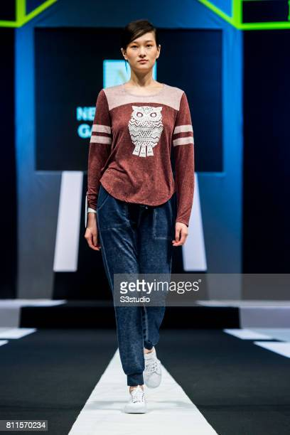 Model showcases designs of New Elegant Garment Limited on the runway on the Day 1 of the Hong Kong Fashion Week for Spring / Summer 2017 at the Hong...