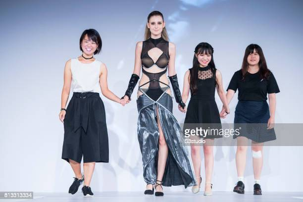 Model showcases designs of Tracy Tang Shuk Wing Ceci Fung Mei Sze and PP Li Ka Po on the runway in the PolyU Intimate Fashion Show 2017 during the...