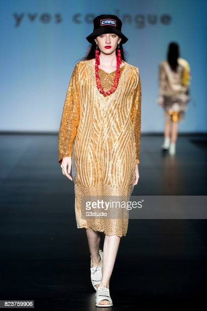 A model showcases designs of Yves Camingue on the runway during the Designers' Collection Show on the Day 3 of the CentreStage Hong Kong 2016 at Hong...