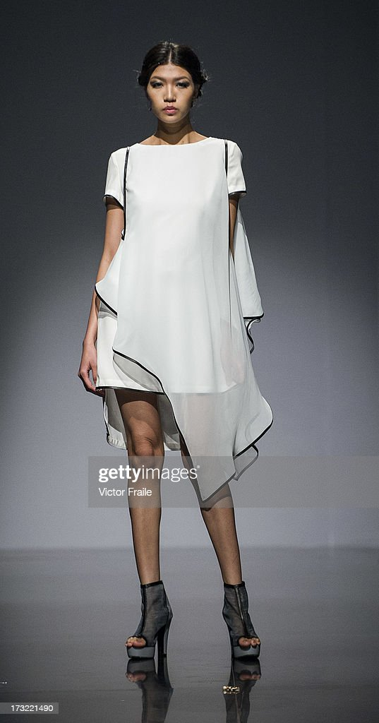 A model showcases designs of Zics on the runway during the Macao Fashion Parade on day 2 of Hong Kong Fashion Week Spring/Summer 2013 at the Hong Kong Convention and Exhibition Centre on July 9, 2013 in Hong Kong, China.