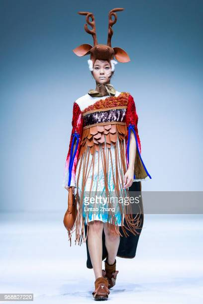 Model showcases designs on runway at Apparel & Art Design College, Xi'an Polytechnic University show during China International College Student...