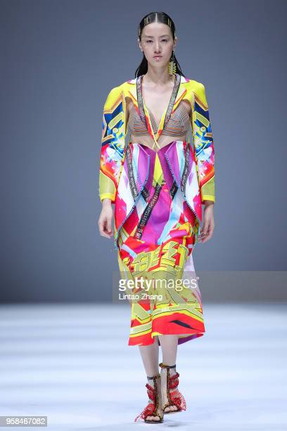 Model showcases designs on runway at Sichuan Fine Arts Institute show during China International College Student Fashion Week 2018 at 751D.Park on...