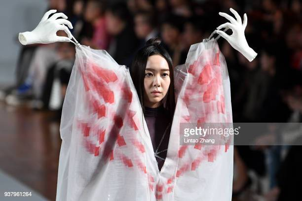A model showcases designs on runway at the 26th China International Young Fashion Designers Contest show during the MercedesBenz China Fashion Week...