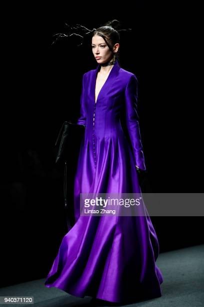 A model showcases designs on runway at the Heaven Gaia show by designer Xiong Ying during the MercedesBenz China Fashion Week A/W 2018/2019 at...