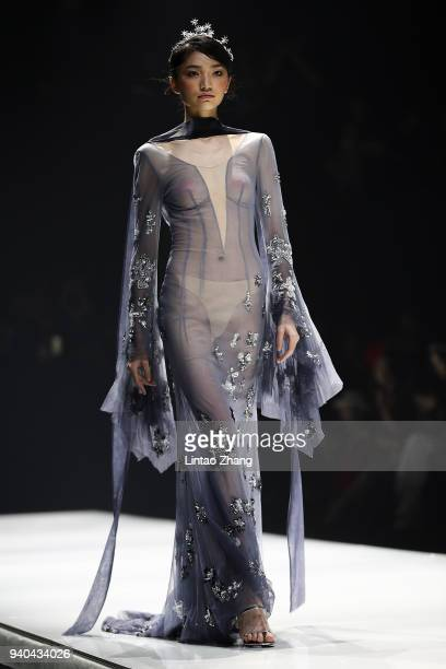 A model showcases designs on runway at the JUSERE show by designer Zhu Guangyan during the MercedesBenz China Fashion Week A/W 2018/2019 at 751DPARK...