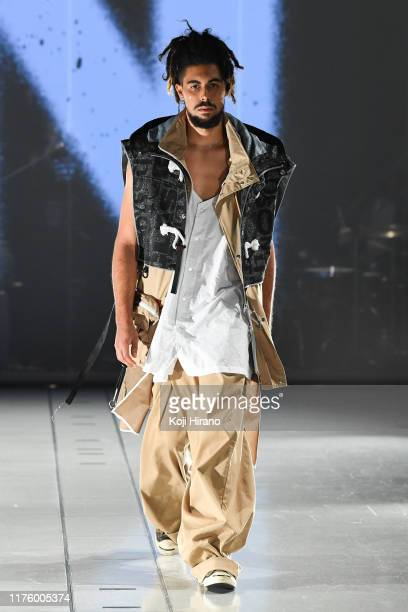 Model showcases designs on runway by BODYSONG during Rakuten Fashion Week TOKYO 2020 S/S on October 15, 2019 in Tokyo, Japan.