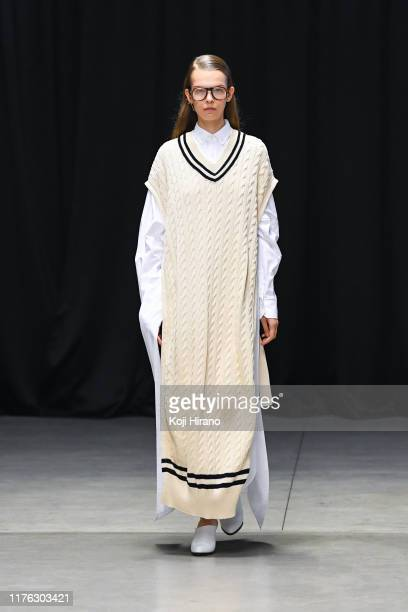 Model showcases designs on runway by HYKE during Rakuten Fashion Week TOKYO 2020 S/S on October 15, 2019 in Tokyo, Japan.