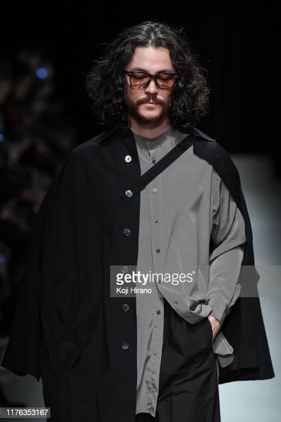 Model showcases designs on runway by RAINMAKER during Rakuten Fashion Week TOKYO 2020 S/S on October 16, 2019 in Tokyo, Japan.