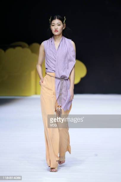 Model showcases designs on runway during Chuhetingxiang show by Yan Chu on day 7 of China Fashion Week 2020 Spring/Summer at The Water Cube on...