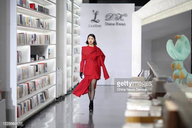 A model showcases designs on runway during the Larome by Yifan Chen DIANA KWAN by Yue Guan collection show on day 7 of the China Fashion Week...