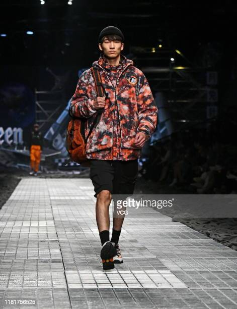 A model showcases designs on runway of Cabbeen collection show on day nine of Shanghai Fashion Week Spring/Summer 2020 on October 17 2019 in Shanghai...