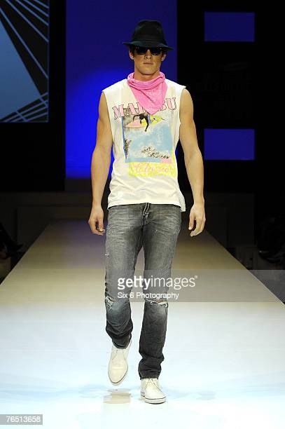 A model showcases designs on the catwalk at the Hot in the City evening parade featuring designs by Bettina Liano Clemente Talarico Flamingo Sands...
